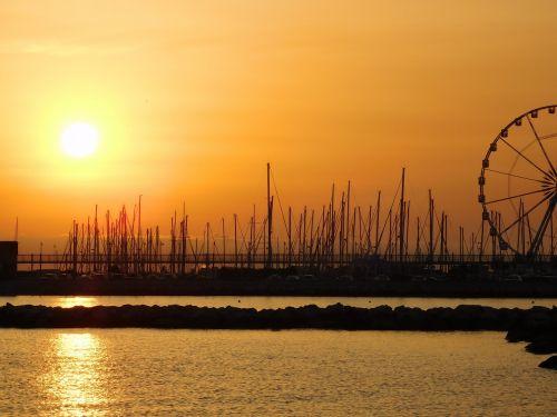 ferris wheel sunrise ocean