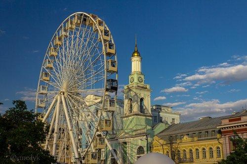 ferris wheel  clock tower  kiev
