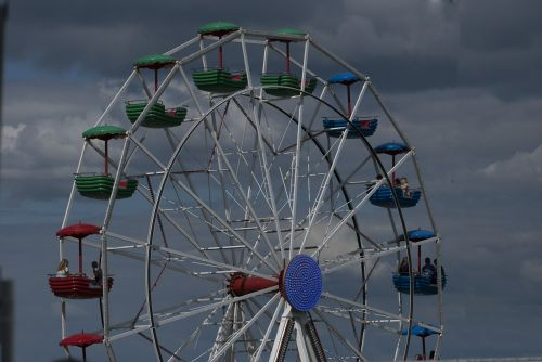 ferris wheel funfair clouds