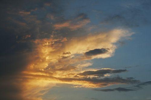 Fiery Flecks In Cloud At Sunset