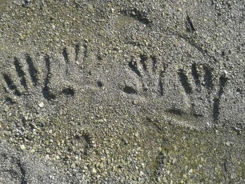 fingerprint beach hands