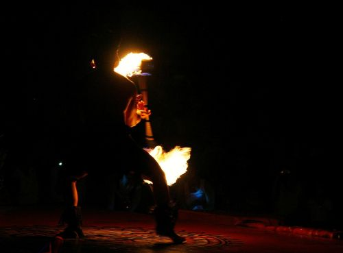 fire dancer silhouette entertainer
