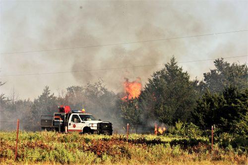 Firemen Fighting Grass Fire