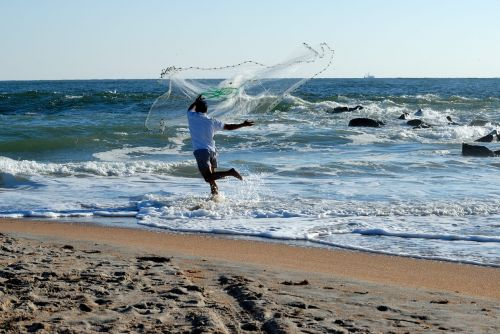 fisherman casting net bait