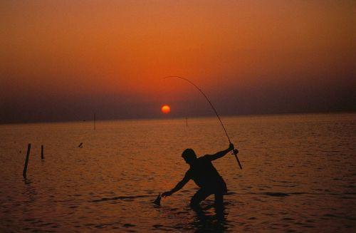 fisherman sunset fishing