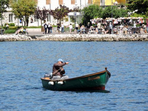 fisherman boat lake