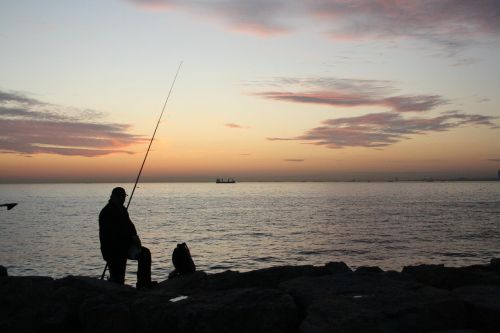 fisherman fisher sunset
