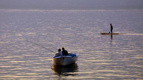 fishermen boat lake