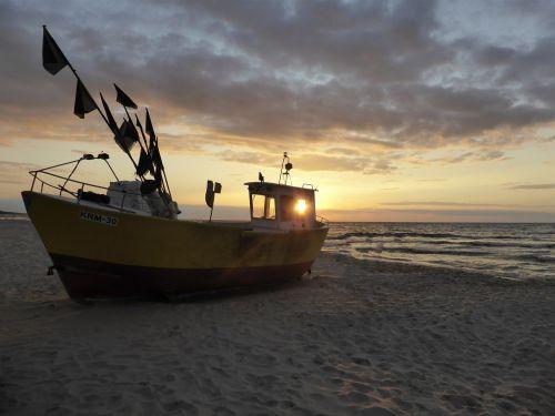 fishing boat the sun beach