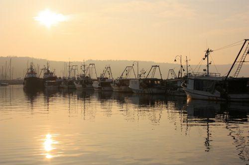 fishing vessels sunset sea