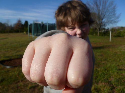fist bump boy outside