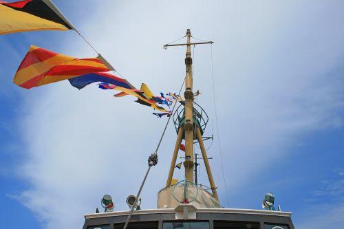 flags on tugboat boat tug