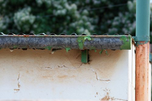 Flaking Gutter And Wall