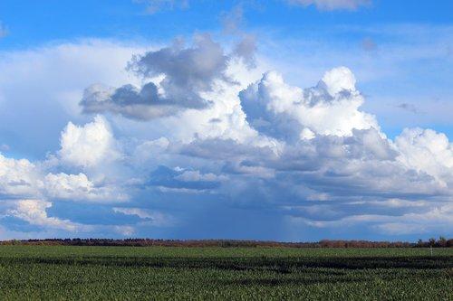 flat land  mecklenburg western pomerania  clouds