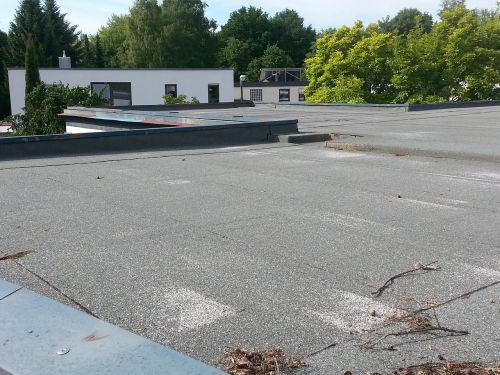 flat roof bituminous felt sealing