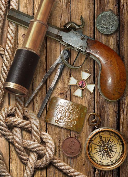 flintlock pistol spyglass compass
