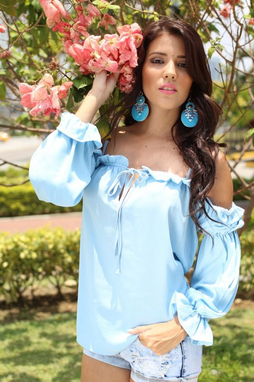 woman flower blue blouse