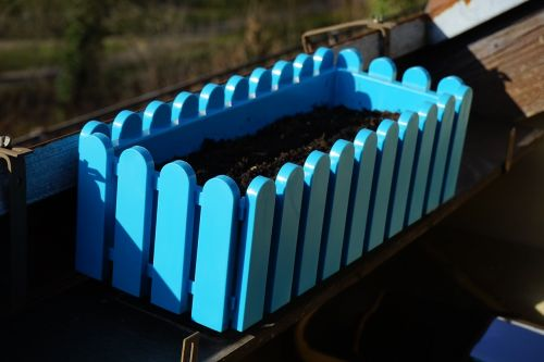 flower box blue balcony
