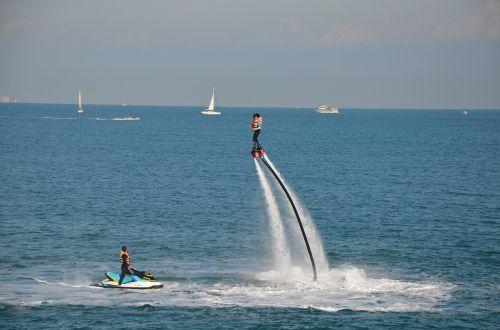 flyboard,vandens sportas,vanduo,Valensija,Viduržemio jūros,papludimys,Viduržemio jūra,jūros dangus,akmenys,smėlis