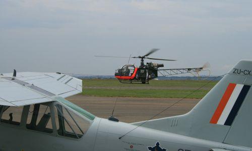 flying activity green grass tarmac