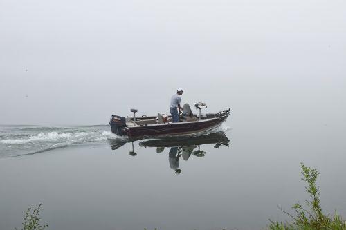foggy morning fisherman lake nature