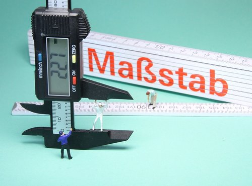 folding rule  calipers  miniature figures
