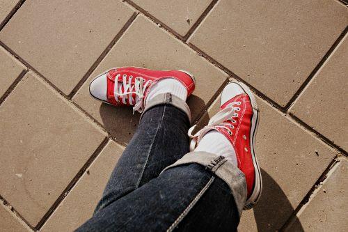 foot crossed legs shoe