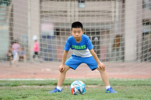 football teenager greenery
