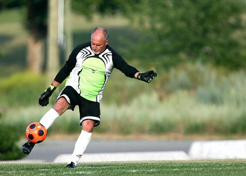football kicking goal tender