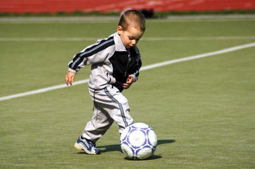 footballer ball boy