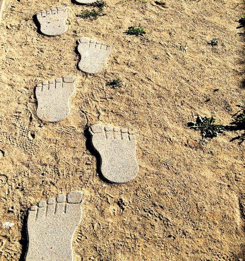 footprints feet sand