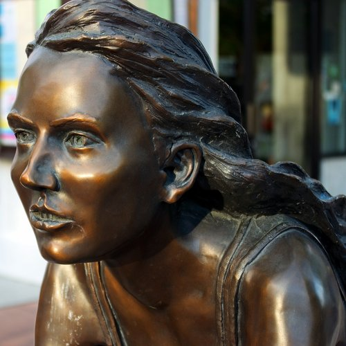 freewheelin bronze sculpture  young  female