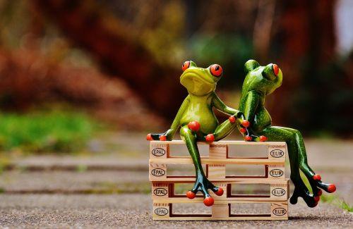 friends sit pallets