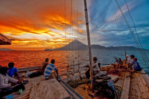 from on board landscape sunset wooden boats