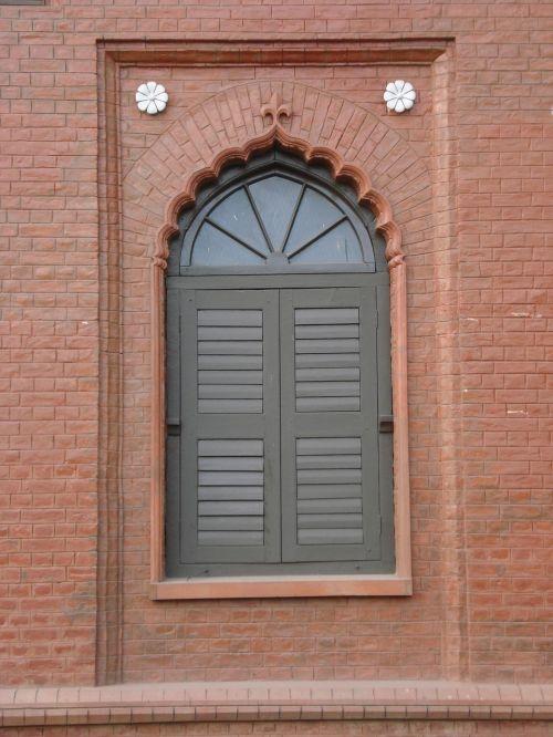 front of curzon hall's window british raj-era building dhaka