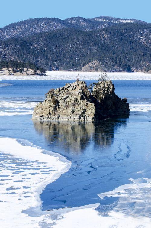 frozen lake rocks mountain lake