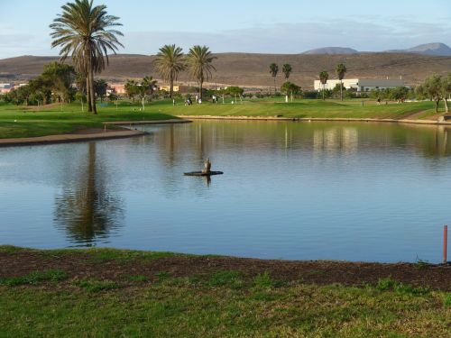 fuerteventura,landscape,canary,mountain,island,outdoors,water,volcanic,golf,golf course,vacation