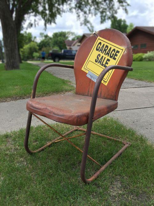 garage sale sign rusty rusty metal chair
