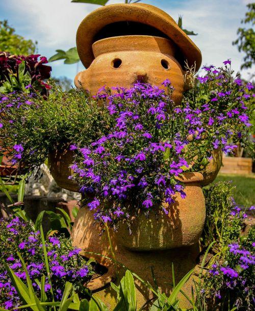 sodas,gėlės,apdaila,vasara,molio figūra