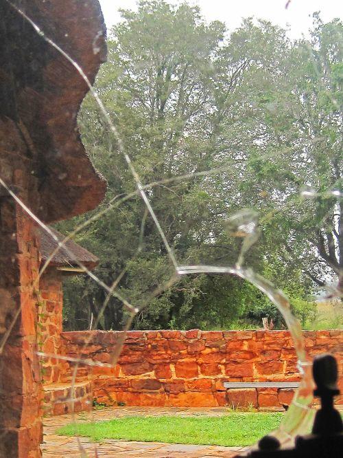 Garden Beyond Broken Window