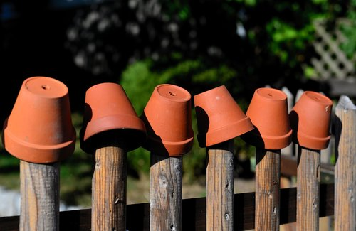 garden fence  flower pots  clay pots