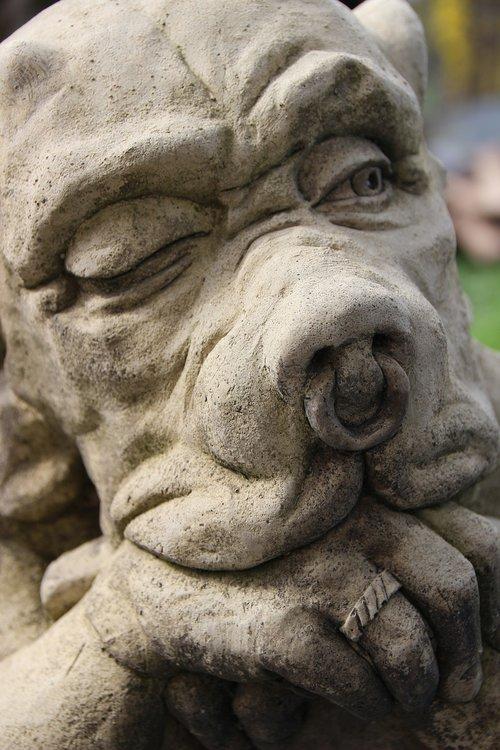 gargoyle shield  sculpture  stone figure