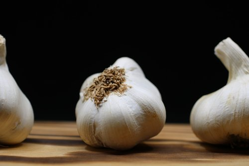 garlic  chopping board  white