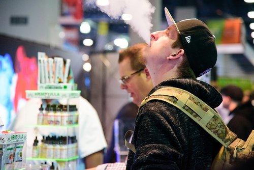 gentleman blowing ecig vapor  electronic cigarette  ecig