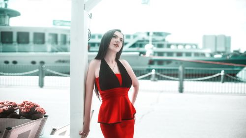 girl in a red dress yacht
