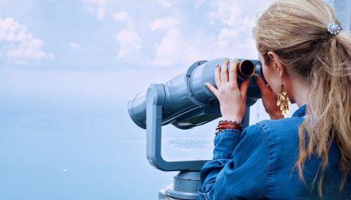 girl sea binoculars