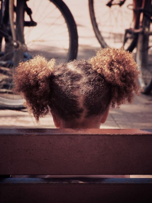 girl pigtails afro hair