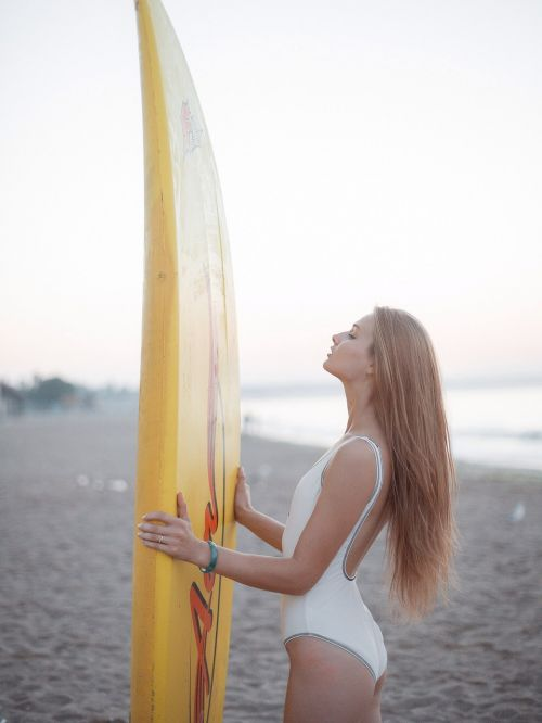 girl surfing board