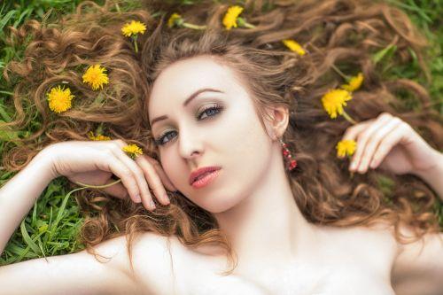 girl dandelions summer