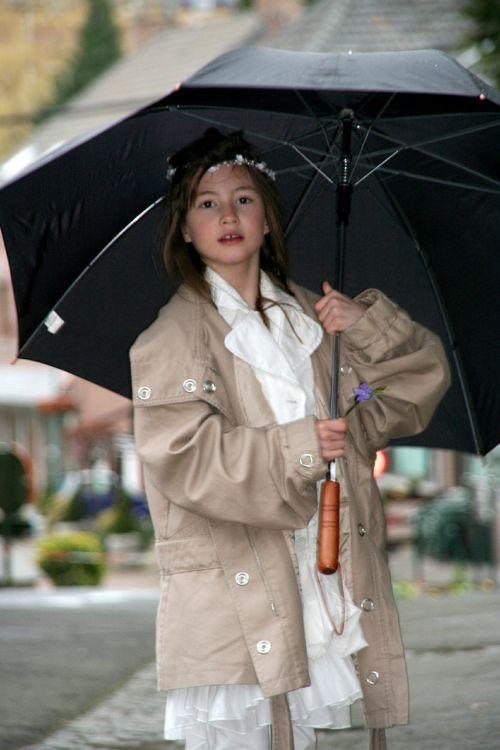 girl umbrella communion